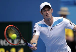 Photo - Andy Murray of Britain makes a forehand return to Stephane Robert of France during their fourth round match at the Australian Open tennis championship in Melbourne, Australia, Monday, Jan. 20, 2014.(AP Photo/Rick Rycroft)