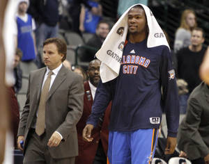 photo - Oklahoma City&#039;s Kevin Durant (35) and head coach Scott Brooks walk of the court following the pre season NBA game between the Dallas Mavericks and the Oklahoma City Thunder at the American Airlines Center in Dallas, Sunday, Dec. 18, 2011. Photo by Sarah Phipps, The Oklahoman