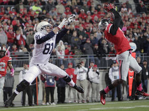 Photo - Ohio State defensive back Corey Brown, right, grabs an interception in the end zone in front of Penn State tight end Adam Breneman during the first quarter of an NCAA college football game Saturday, Oct. 26, 2013, in Columbus, Ohio. (AP Photo/Jay LaPrete)