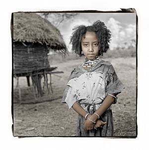 Photo - A portrait by Seattle-based photographer Phil Borges shows Rufo, a 7-year-old Ethiopian girl. Borges' portraits will be displayed as a part of the annual Puterbaugh Festival at the University of Oklahoma.  Photo provided