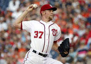 Photo - Washington Nationals starting pitcher Stephen Strasburg throws during the third inning of an interleague baseball game against the Baltimore Orioles at Nationals Park, Monday, July 7, 2014, in Washington. (AP Photo/Alex Brandon)