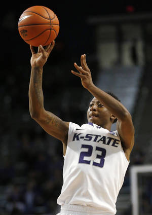 Photo - Kansas State guard Nigel Johnson shoots during the second half of an exhibition NCAA college basketball game against Pittsburg State in Manhattan, Kan., Friday, Nov. 1, 2013. Johnson scored 15 points as Kansas State defeated Pittsburg State 75-54. (AP Photo/Orlin Wagner)