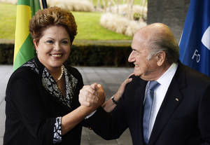 "Photo - FIFA President Joseph ""Sepp"" Blatter, right, meets with Dilma Rousseff, President of Brazil, left, prior to talks at the FIFA headquarters in Zurich, on Thursday, Jan. 23, 2014.  (AP Photo/Keystone,Steffen Schmidt)"