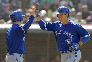 Photo -   Toronto Blue Jays' Kelly Johnson, right, is congratulated by teammate Adam Lind after he hit a solo home run in the ninth inning against the Cleveland Indians in a baseball game in Cleveland on Saturday, April 7, 2012. (AP Photo/Amy Sancetta)