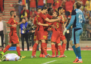 Photo - Belgium's Dries Mertens, right, gets congratulations by his team after he scored during a friendly soccer match against Tunisia, at the King Baudouin stadium in Brussels, Saturday, June 7, 2014. Belgium will play against South Korea, Russia and Algeria in Group H of the World Cup 2014 in Brazil. (AP Photo/Yves Logghe)
