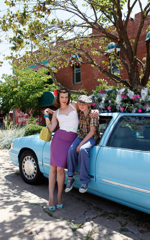 "Photo - Milla Jovovich as Olive, a nomadic European con artist trying to settle in Oklahoma, and Spencer List as her son Bobby, in the film ""Bringing Up Bobby,"" directed by Famke Janssen. The film will screen at the deadCenter Film Festival on Saturday. MONTEREY MEDIA PHOTO <strong></strong>"