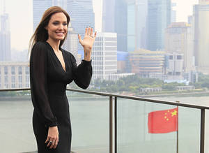 "Photo - Actress Angelina Jolie waves during a promotion tour for her movie ""Maleficent"" in Shanghai, China Tuesday, June 3, 2014. (AP Photo)"