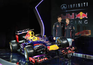 Photo - In this photo dated Sunday Feb. 3, 2013 and provided by Red Bull Racing, Red Bull racing drivers Mark Webber, left, and Sebastian Vettel stand alongside the new car during the Infiniti Red Bull Racing RB9 launch in Milton Keynes, England. (AP Photo/Richard Heathcote, HO)