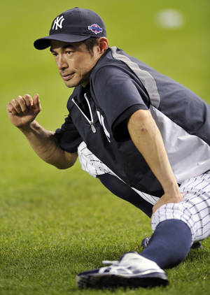 photo -   New York Yankees' Ichiro Suzuki stretches during baseball practice Friday, Oct. 5, 2012, at Yankee Stadium in New York for an American League division series. (AP Photo/Bill Kostroun)