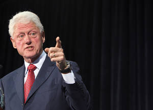 photo -   Former President Bill Clinton gestures as he speaks at Florida International University, Tuesday, Sept. 11, 2012 in Miami, as he campaigns for President Barack Obama. (AP Photo/Wilfredo Lee)