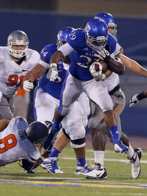 photo - Kansas' James Sims (29)) rushes during fourth quarter of the college football game between Oklahoma State University (OSU) and the University of Kansas (KU) at Memorial Stadium in Lawrence, Kan., Saturday, Oct. 13, 2012. Photo by Sarah Phipps, The Oklahoman