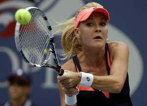 Photo - Agnieszka Radwanska, of Poland, returns a shot to Spain's Silvia Soler-Espinosa in the first round of the 2013 US Open tennis tournament, Monday, Aug. 26, 2013, in New York. (AP Photo/David Goldman)
