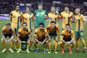Photo - FILE - In this Oct. 11, 2013 file photo, Australia soccer team poses prior to the start their international soccer friendly match between France and Australia at the Parc Des Princes stadium in Paris, France. Background from left: Rhys Williams, Robbie Kruse, Mitchell Langerak, James Holland, Mile Jedinak and Mark Bresciano. Foreground from left: David Carney, Lucas Neill, Tim Cahill, Matty McKay and Luke Wilkshire. (AP Photo/Francois Mori, File)