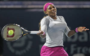 Photo - Serena Williams of the U.S. returns the ball to Jelena Jankovic of Serbia during the quarterfinals of the Dubai Duty Free Tennis Championships in Dubai, United Arab Emirates, Thursday, Feb. 20, 2014. (AP Photo/Kamran Jebreili)