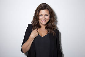 "Photo - This Feb. 6, 2013 file photo shows actress Tiffani Thiessen posing for a portrait in New York. Thiessen, best known for her former role as Kelly Kapowski on TV's ""Saved by the Bell,"" says she had no idea at the time of how popular the show was. She says she's grateful she grew up in the limelight before TMZ and other 24 hour media outlets and gossip blogs came along. She currently stars in the USA series ""White Collar."" (Photo by Amy Sussman/Invision/AP)"