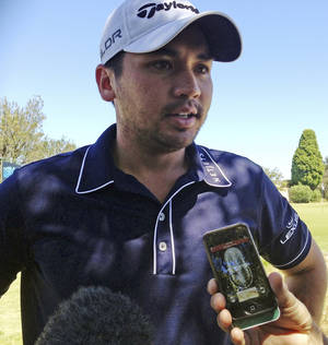Photo - Australian golfer Jason Day comments to journalists at Royal Melbourne golf course in Melbourne, Australia, Monday, Nov. 18, 2013. Day has confirmed that eight of his relatives died in Typhoon Haiyan in the Philippines, including his grandmother. (AP Photo/Dennis Passa)