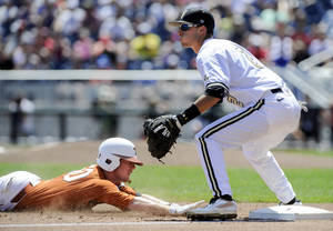 Photo - Texas' Zane Gurwitz, left, reaches third base on a triple against Vanderbilt third baseman Tyler Campbell (2) in the inning of an NCAA baseball College World Series game in Omaha, Neb., Friday, June 20, 2014. (AP Photo/Eric Francis)