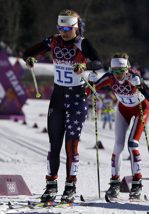 Photo - Jessica Diggins, of the United States, competes during the women's cross-country 15k skiathlon at the 2014 Winter Olympics, Saturday, Feb. 8, 2014, in Krasnaya Polyana, Russia. (AP Photo/Kirsty Wigglesworth)