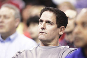 Photo - Dallas Mavericks owner Mark Cuban was one of just two NBA owners to vote against the Seattle SuperSonic's relocation to Oklahoma City. On Wednesday, he said he would still vote the same way.  AP PHOTO