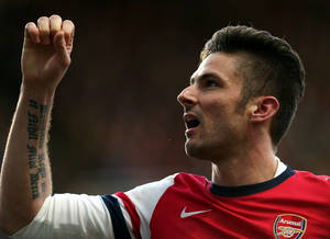 Photo - Arsenal's Olivier Giroud celebrates his goal during their English Premier League soccer match against Newcastle United at St James' Park, Newcastle, England, Sunday, Dec. 29, 2013. (AP Photo/Scott Heppell)