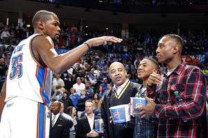 photo - Kevin Durant (35) greets Trey Johnson before the NBA game between the Oklahoma City Thunder and the Boston Celtics at the Chesapeake Energy Arena in Oklahoma City, Sunday, March 10, 2013. Photo by Sarah Phipps, The Oklahoman