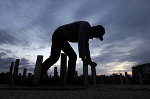 Photo - In this Thursday, Oct. 11, 2012, photo, Ford Smith works on a new home under construction in Chicago. U.S. builders increased their spending on construction projects in October by the largest amount in five months, led by a surge in housing.  (AP Photo/Nam Y. Huh)