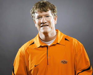 Photo - Gunter Brewer became the third offensive coach to leave OSU program after the 2010. Brewer will join the Mississippi staff. Photo by Bryan Terry, The Oklahoman