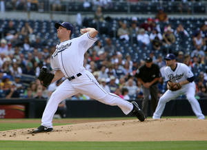 Photo - San Diego Padres starting pitcher Robbie Erlin throws against the Arizona Diamondbacks during the first inning of a baseball game on Thursday, Sept. 26, 2013, in San Diego. (AP Photo/Don Boomer)
