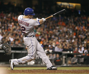 Photo -   New York Mets' Scott Hairston (12) hits a solo home run off San Francisco Giants' relief pitcher Santiago Casilla (46) during the tenth inning of a baseball game in San Francisco, Monday, July 30, 2012. New York Mets won 8-7. New York Mets won 8-7. (AP Photo/Tony Avelar)