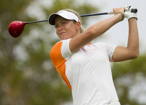Photo - Suzann Pettersen of Norway, watches her drive off the second tee during the third round of the LPGA Lotte Championship golf tournament at the Ko Olina Golf Club Friday, April 19, 2013, in Kapolei, Hawaii. (AP Photo/Eugene Tanner)