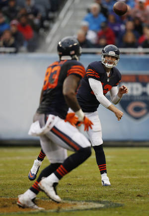 Photo - Chicago Bears quarterback Josh McCown (12) passes to tight end Martellus Bennett (83) during the first half of an NFL football game against the Baltimore Ravens, Sunday, Nov. 17, 2013, in Chicago. (AP Photo/Charles Rex Arbogast)