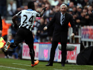 Photo - Newcastle United's captain Chieck Tiote, left, celebrates his goal with manager Alan Pardew, right, but the gaol was later disallowed, during their English Premier League soccer match against Manchester City at St James' Park, Newcastle, England, Sunday, Jan. 12, 2014. (AP Photo/Scott Heppell)