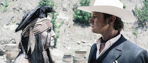 "Photo - This film publicity image released by Disney shows Johnny Depp as Tonto, left, and Armie Hammer as The Lone Ranger, in a scene from ""The Lone Ranger."" (AP Photo/Disney Enterprises, Inc.) ORG XMIT: NYET507"