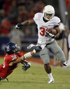 photo - Oklahoma State's Jeremy Smith (31) gets by Arizona's Jared Tevis (38) during the college football game between the University  of Arizona and Oklahoma State University at Arizona Stadium in Tucson, Ariz.,  Saturday, Sept. 8, 2012. Photo by Sarah Phipps, The Oklahoman