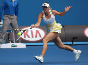 Photo - Caroline Wozniacki of Denmark makes a forehand return to Garbine Muguruza of Spain during their third round match at the Australian Open tennis championship in Melbourne, Australia, Saturday, Jan. 18, 2014.(AP Photo/Aaron Favila)