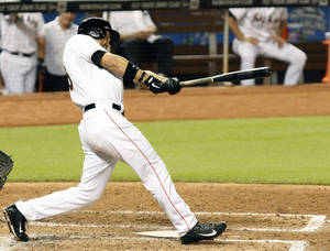 Photo - Miami Marlins Garrett Jones hits a three run home run in the seventh inning during a baseball game  against the Chicago Cubs, Tuesday, June 17, 2014 in Miami. (AP Photo/El Nuevo Herald, Hector Gabino)  MAGS OUT