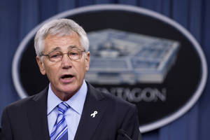 "Photo - FILE - In this May 1, 2014 file photo, Defense Secretary Chuck Hagel speaks to reporters at the Pentagon.  Hagel said in an interview broadcast Friday that the focus of an investigation into alleged delayed treatments and deaths in the Veterans Administration's health care system should be to ""fix the problem"" rather than fire VA Secretary Eric Shinseki.   (AP Photo/Manuel Balce Ceneta)"
