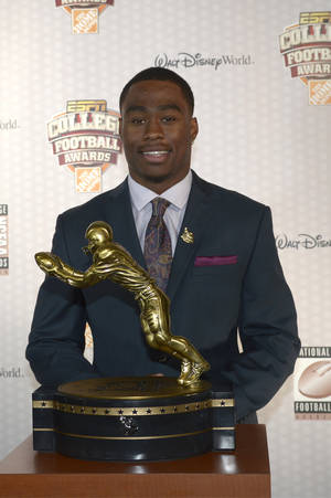 Photo - Oregon State receiver Brandin Cooks poses with the Biletnikoff Award after winning the honor during the College Football Awards show in Lake Buena Vista, Fla., Thursday, Dec. 12, 2013. (AP Photo/Phelan M. Ebenhack)