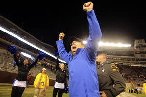 Photo - Duke head coach David Cutcliffe celebrates in Lane Stadium after winning 13-10 over Virginia Tech in Blacksburg, Va., Saturday, Oct. 26 2013. (AP Photo/The Roanoke Times, Matt Gentry)