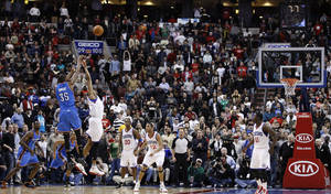 Photo - Oklahoma City Thunder's Kevin Durant (35) shoots the game-tying three-pointer over Philadelphia 76ers' Andre Iguodala in the second half of an NBA basketball game, Wednesday, March 9, 2011, in Philadelphia. Oklahoma City won  110-105 in overtime. (AP Photo/Matt Slocum)