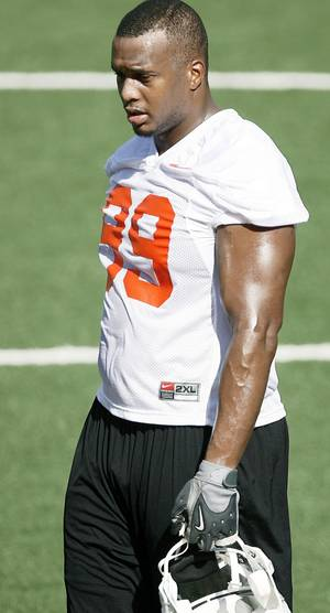 Photo - OSU defensive end Richetti Jones calls his mother his best friend.  Photo by Bryan Terry,  The Oklahoman