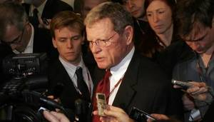 Photo - U.S. Senator from Oklahoma James  Inhofe, center, speaks with journalists at a U.N. Climate Summit in Copenhagen, Thursday Dec. 17, 2009.  (AP Photo/Virginia Mayo)