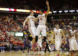 Photo - Iowa State guard Matt Thomas, left, celebrates with teammate Naz Long (15) after making a 3-point basket during the first half of an NCAA college basketball game against Kansas State, Saturday, Jan. 25, 2014, in Ames, Iowa. (AP Photo/Charlie Neibergall)