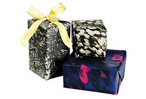 Photo - This product image released by One Kings Lane shows gift-wrapped boxes with paper designed by stylist-designer Rachel Zoe. Zoe is among the tastemakers that partnered with the site for the One Kings Lane Holiday Charity Series. (AP Photo/One Kings Lane)