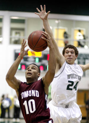 Photo - HIGH SCHOOL BASKETBALL: Edmond Memorial's Jordan Woodard shoots as Edmond Santa Fe's Connor Bays defends during the boys' Edlam basketball game between Edmond Santa Fe and Edmond Memorial at Edmond Santa Fe High School in Edmond, Okla. , Tuesday, Jan. 24, 2012. Photo by Sarah Phipps, The Oklahoman