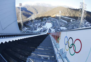 Photo - The photo taken with a fisheye lens show the start area on the large hill of the ski jumping stadium for the 2014 Winter Olympics, Tuesday, Feb. 4, 2014, in Krasnaya Polyana, Russia. (AP Photo/Dmitry Lovetsky)