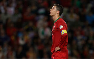 Photo - Portugal's Cristiano Ronaldo reacts after a teammate missed a shot at Israel's goal during their 2014 World Cup qualifying group F soccer match Friday, Oct. 11 2013, at the Alvalade stadium in Lisbon. The game ended in a 1-1 draw. (AP Photo/Armando Franca)