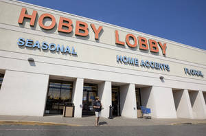 Photo - A woman leaves a Hobby Lobby store in Little Rock, Ark. AP Photo