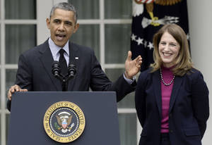 Photo - President Barack Obama, stands with his nominee to become Health and Human Services secretary, Budget Director Sylvia Mathews Burwell, while speaking in the Rose Garden of the White House in Washington, Friday, April 11, 2014, where he made the announcement. Burwell would replace Kathleen Sebelius who announced her resignation Thursday. (AP Photo/Susan Walsh)