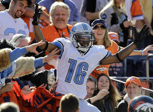 Photo - FILE - In this Oct. 30, 2011 file photo, Detroit Lions wide receiver Titus Young (16) celebrates after catching a pass for a touchdown against the Denver Broncos during the first quarter of an NFL football game in Denver. The former Lions receiver  could face a warrant for his arrest Tuesday, Aug. 27, 2013, if he does not appear in court for a pre-trial hearing in an attempted burglary case amid his family's concerns about his mental health. (AP Photo/Joe Mahoney, File)